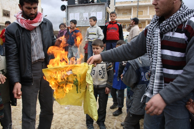 Burning of Hizballah flag in northern Syria